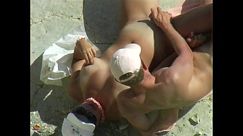 Nude Beach Naked Gymnastics (horny slut finds a fun way to flash her spread pussy to her friends)